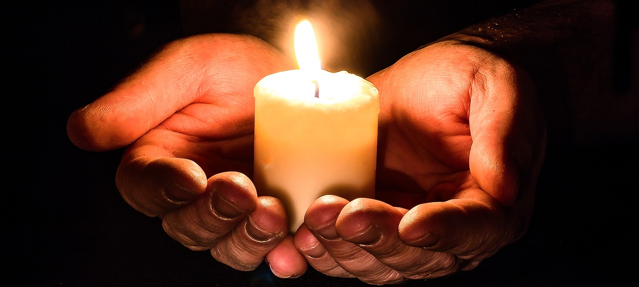 Hope: holding candles in palms: Hope After Egg Donation