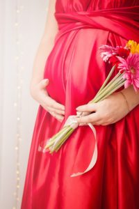 Healthy pregnant lady with flowers, pic for foods to avoid