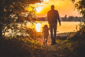 gay father surrogacy baby orign: walking sunset